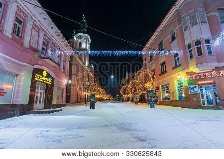 Uzhgorod, Ukraine - 06 Jan, 2019: Winter Night In Town. Wonderful Blue And Yellow Christmas Illumina