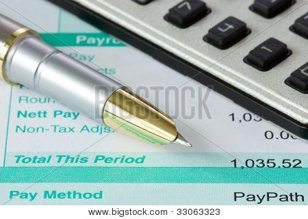 Pen,calculator And Payslip