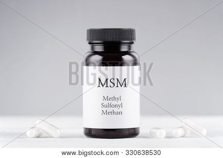 Nutritional Supplement Msm, Sulfur, Methylsulfonylmethan Bottle And Capsules On Gray