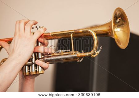 Trumpet In Trumpeter Hands. It Is A Brass Instrument Commonly Used In Classical And Jazz Ensembles,