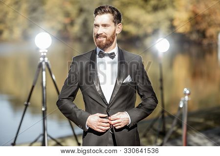 Portrait Of An Elegant Man Strictly Dressed In Tuxedo As A Well-known Actor During The Awards Ceremo