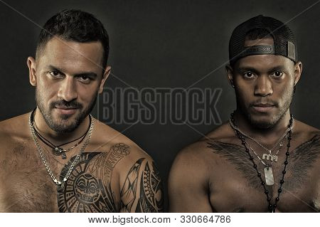 Fashion Models Isolated On Black Background. Brutal Men With Tattooed Bodies. Sportsmen With Muscles