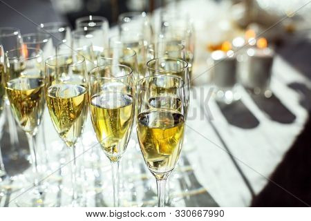 Glasses of sparkling wine close-up. Banquet service.
