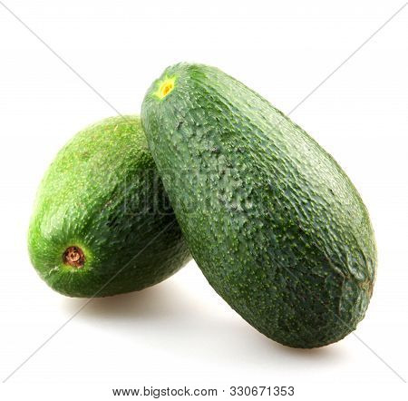 Whole Avocado Isolated On White Background. The Avocado Or Persea Americana Is A Fruit That Belongs