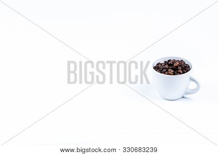 White Porcelain Cup With Roasted Coffee Bean Isolated On White Background