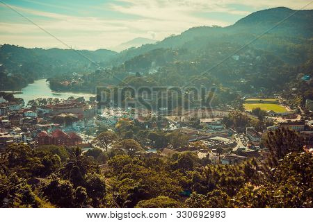 Beautiful top city view of Kandy. Sri Lanka tourism. Ceylon travel. Ecotourism concept. Town in jungle. Mountains landscape. Asia background horizontal. Foggy cityscape. Copy space. Pilgrimage place poster