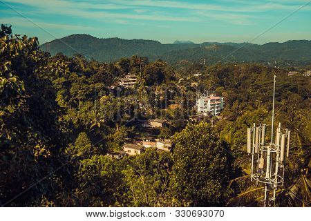 Beautiful top view. Town Kandy. Sri Lanka tourism. Ceylon travel. Ecotourism concept. Hotel building, guest house in jungle. Mountain resort. Asia background horizontal. Copy space. Tranquil landscape poster