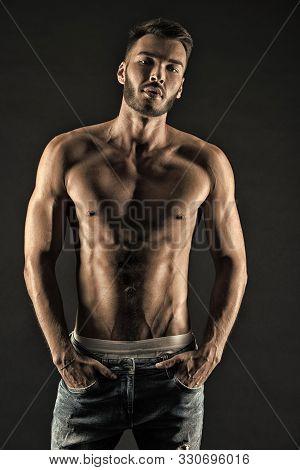 Masculinity Is Sexy. Man Muscular Torso Tense Muscles Veins Put Hands In Pockets Denim Pants. Macho