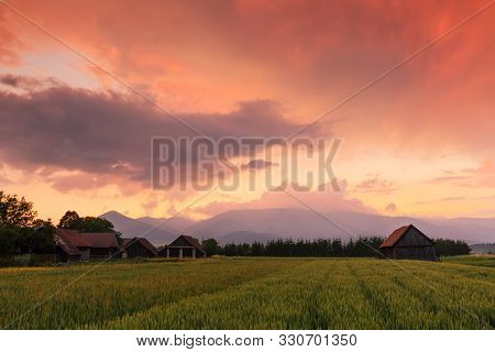 Clearing Storm Over A Rural Landscape With A Traditional Barn In Turiec Region, Central Slovakia.