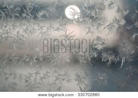 First snow. Frosty pattern. of frozen ice with snow crystals and snowflakes.Ice and snow texture.pan