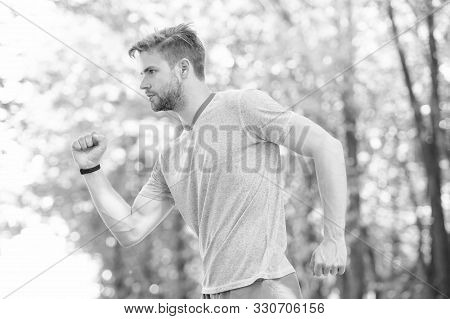 Running. Sportsman Full Of Energy. Man Making Sport Outdoor. Sportswear Fashion. Health And Fitness.