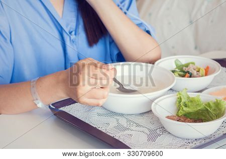 Woman Patient Hand With Iv Solution Eating Food For Patient On Bed In Hospital. Health Medical Insur