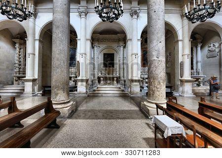 Lecce, Italy - June 1, 2017: People Visit Basilica Di Santa Croce In Lecce, Italy. The Baroque Landm