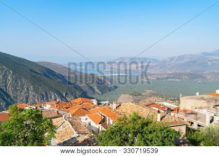 View From  Delphi, Overlooking The Towns Roof-tops And Down Valley To Part Od Corinthian Coast And L