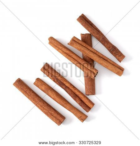 Cinnamon sticks isolated over white background closeup. Canella spice. Aromatic condiment background. Flat lay, top view..
