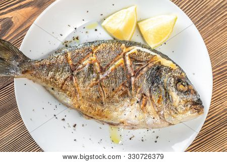 Fried Sea Bream With Fresh Thyme And Lemon