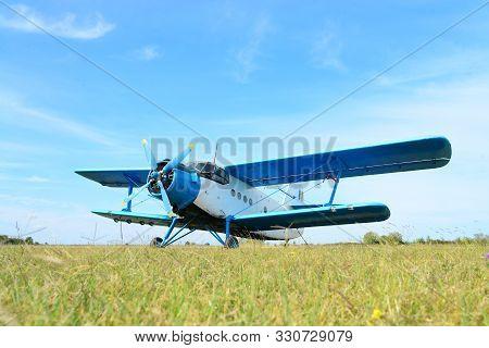 Small Utilitarian Airplane Detail At Aerodrome With Blue Sky