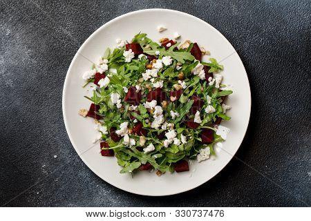 Fresh Salad With Arugula, Feta Cheese, Walnut And Beet On White Plate. Beet Salad