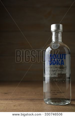 Mykolaiv, Ukraine - October 03, 2019: Bottle Of Absolut Vodka On Table Against Wooden Background. Sp