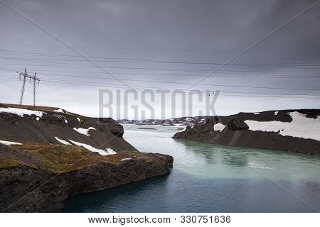 Power Lines Stretch Across The Lake In Iceland
