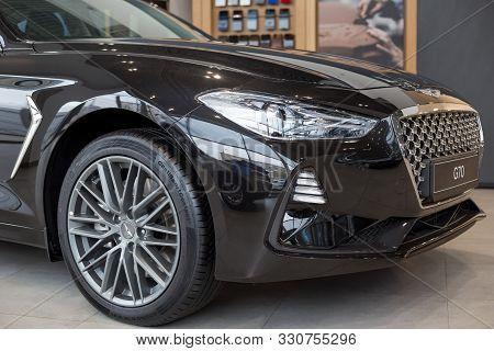 Russia, Izhevsk - October 10, 2019: New Modern Car Genesis G70 In The Hyundai Showroom. Cropped Imag
