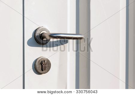 Entrance Door Handle Close Up. Lock And Handle On The Door. Reinforced Door Lock. Doorknob At A Whit