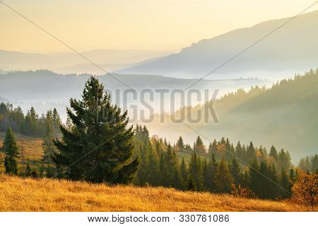 Mountain Hills With Mist Early In The Morning. Stunning Autumn Sunrise Over Mountains. Fall Landscap