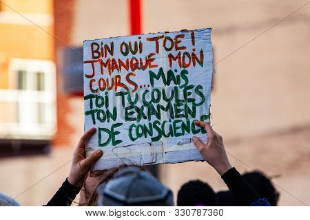 A French Sign Reads I Miss My Class, But You Fail Your Examination Of Conscience As Environmental Pr