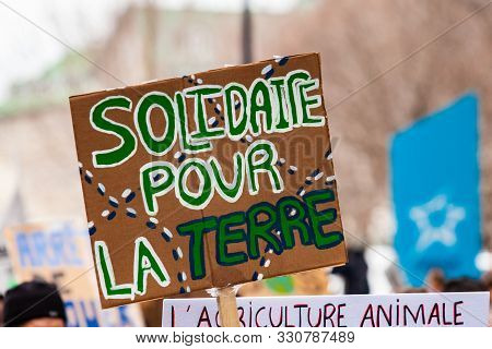 A French Placard Is Seen Close Up, Saying Solidarity For The Earth, As Environmentalists March Again