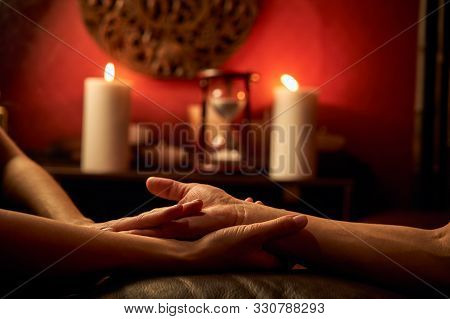 A Woman Does Acupressure Fingers For A Man. Hand Massage With Intimate Lighting. Prelude Before Maki