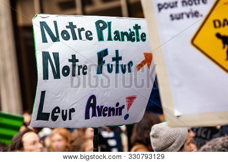 A French Placard Is Viewed Up Close, Saying Our Planet, Our Future, Their Future, As Environmentalis