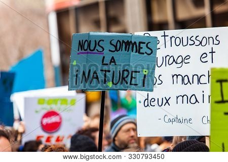 A Homemade French Sign Saying We Are Nature Is Viewed Close-up As Environmental Protestors March On