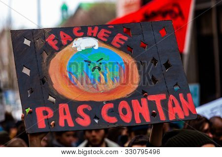 A Conceptual French Banner Showing An Angry And Burning Planet Earth Is Seen On A Street As Environm