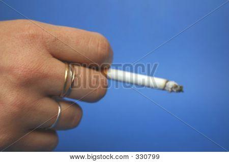 Cigarette Between Fingers