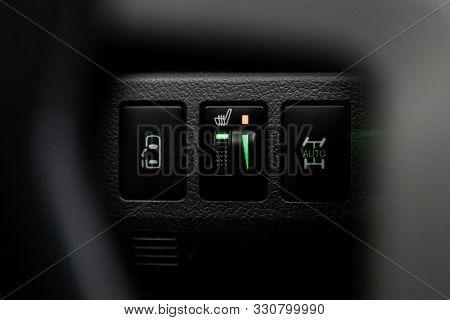Novosibirsk, Russia - September 29, 2019:  Toyota Noah, Close-up Of Black Of Seat Heating, Suspensio