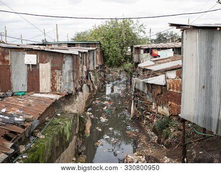 Polluted water flows through the Kibera slum in Africa.