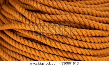 Yellow Cord Background, Close-up Photo. Braided Rope Texture. Ship Or Rock Climbing Tackle. Natural