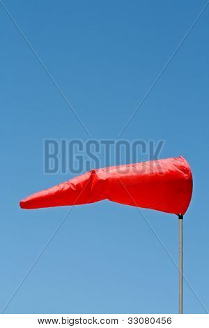 Windsock and clear sky a great image for your job.