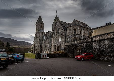 Fort Augustus, Scotland, December 17, 2018: The Abbey Highland Club, Full Of Mold And Lichen In Its