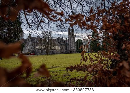 Fort Augustus, Scotland, December 17, 2018: The Abbey Highland Club Clock Tower And Its Garden, Acro