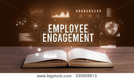 EMPLOYEE ENGAGEMENT inscription coming out from an open book, creative business concept