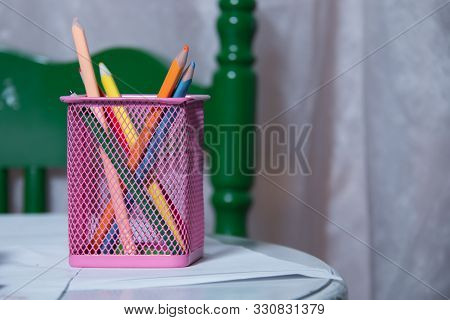 Colored Pencils In A Pencil Case On White Background . Color Pencils In Pink Case On White Backgroun