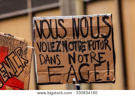 A French Sign Saying You Rob Us Of Our Future In Our Face Is Held By An Environmental Protestor Duri