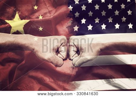 Trade War Between Usa And China Concept. Two Clenched Fists Punch Each Other On Usa And China Flag B