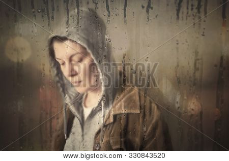 Lonely Sad Woman Behind The Wet Window