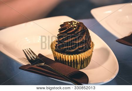 Close Up Of Chocolate Cupcake Food. Healthy Food. Sweet Food. Nutritious Food. Chocolate Cup Cake On