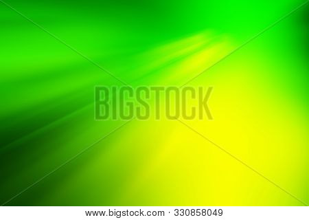 Natural Green Yellow Blurred Background. Green Yellow Bokeh On Nature Defocus Abstract Blur Backgrou