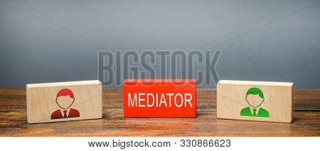 Wooden Blocks With The Word Mediator And Two Parties To The Dispute. Settlement Of Disputes By Media