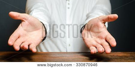 A Man Holds Out His Hands In An Emotional Expression Of Amazement. Show The Cause Of Grief Or Surpri