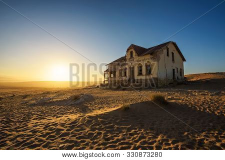 Sunrise Above An Abandoned House In Kolmanskop Ghost Town Located In Southern Namibia Near The Town